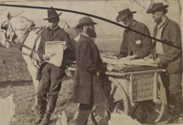 photcl 300 v 1 p 91 - A_group_of_four_men_stand_around_a_horsedrawn_cart_looking_at_newspapers.jpg